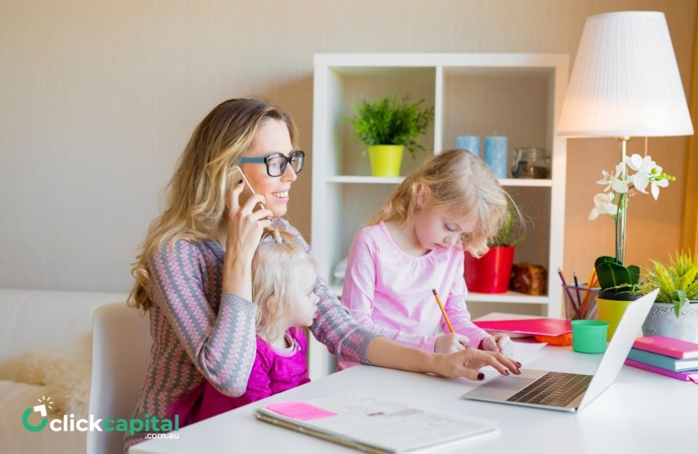 mom with daughters working from home