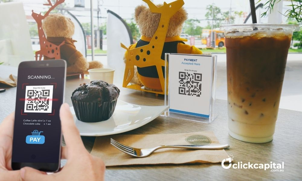 man scanning qr code for cashless payment in a cafe